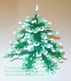 Free detailed tutorial with step by step photos on how to make a Christmas Tree out of seed beads and wire. Great for beginners!