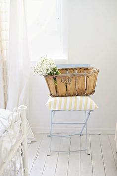 old french cafe chair vintage produce crate, white flowers, whitewashed floorboards abeachcottage.com