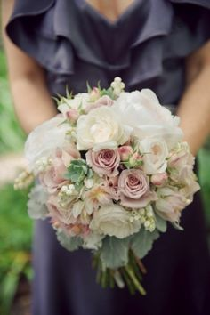 Roses, succulents, dusty miller, andromeda, and blushing bride protea
