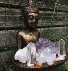 Here are over 20 photos of beautiful home altars with great feng shui to inspire the creation of your own home altar!: Buddha with a Tray of Crystals Altar
