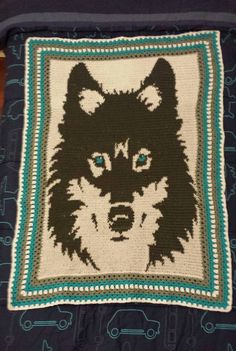Tapestry crochet wolf blanket. Used www.stitchboard.com to create the pattern from an image