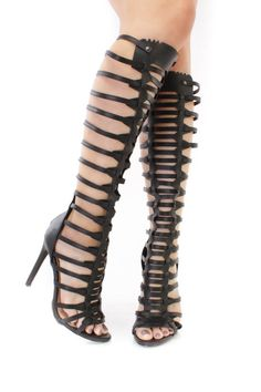 These sexy and stylish single sole gladiator heels are a must have! The features include a faux leather upper in a strappy design, peep toe, back zipper closure, smooth lining, and cushioned footbed. Approximately 4 1/2 inch heels, 13 inch circumference, and 15 inch shaft.