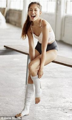 New clothes: She models the latest collection, which features leggings and leg warmers...