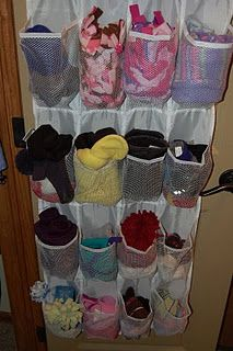 winter hats mittens etc. in shoe organizer by front door