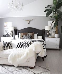 neutral but bold and beautiful bedroom with Beni Ourain rug, leather studded bed, brass longhorn skull, and black and white accents- - Modern Bedroom Suites, Dream Bedroom, Glam Master Bedroom, Budget Bedroom, Master Bedrooms, Modern Bedroom, Bedroom Simple, Master Room, Gold Bedroom