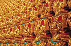 """""""The Global Pursuit of Happiness, or: The Army of Luck"""" is an art installation of 520 Japanese Maneki Neko cat figurines (the waving cats found at many Asian businesses). The installation was created by German artist Boris Petrovsky and debuted last month at the Art Karlsruhe festival in Germany."""