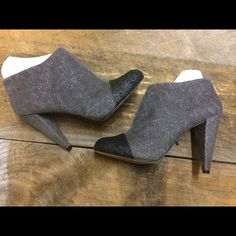 Vince Camuto Glitter Booties Beautiful glitter booties by Vince Camuto. Size 8.5 but these run small IMO.  Fun gray glitter with black glitter toes. Perfect to spice up any outfit!  Like new, worn once.   ALL SALES FINAL. PLEASE ASK ANY QUESTIONS PRIOR TO PURCHASING Vince Camuto Shoes Ankle Boots & Booties