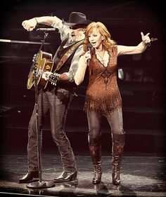 Kix Brooks and Reba McEntire perform during Reba, Brooks & Dunn: Together in Vegas at The Colosseum on June 19, 2015, in Las Vegas.