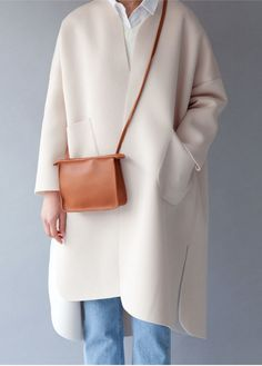 Team a cross-body purse with a soft cream duster, the perfect team this fall.