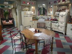Love that big piggy on top of the fridge. Hot in Cleveland painted concrete kitchen floor. Also enameled Magic Chef oven from and GE combination icebox from 1920s Kitchen, Old Kitchen, Kitchen Sets, Vintage Kitchen, Kitchen Stuff, Concrete Kitchen Floor, Kitchen Flooring, Cool Ideas, American Interior