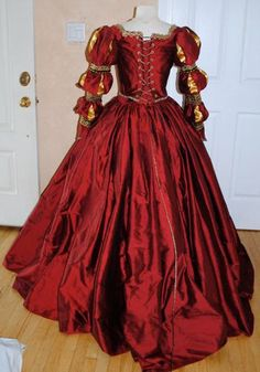 Tudor Costume. I love the deep red and the sleeves!!!