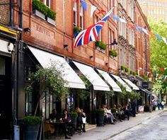 Monmouth Street showing the exterior of Covent Garden Hotel and Brasserie Max, dinners are eating at the outside tables
