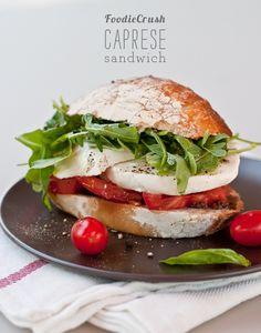 easy buffalo mozzarella, tomato, arugula, and olive tapenade sandwich