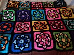 Thank you /u/whythehellamihere, you inspired me to make myself a Stained glass Afghan. - Imgur