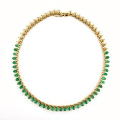 Rasvihar Oval Emerald Necklace  This delicately handcrafted necklace elegantly showcases the lustrous emeralds in all their sophisticated glamour! The beautifully curved necklace creates a natural setting for the gemstones in the form of functional half bezels. The enchanting half halo of oval cut emeralds extend to the back of the necklace.  Shop Online: www.parisera.com/products/rasvihar-oval-emerald-necklace  Subscribe to our newsletter here: www.rasvihar.com/newsletter/