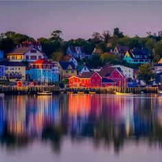 The town of Lunenburg is a UNESCO World Heritage site and is a place you cannot miss on the south shore of Nova Scotia. If you drive to the opposite side near the golf course you get a beautiful view of the harbour. via canada Nova Scotia Travel, Visit Nova Scotia, Lunenburg Nova Scotia, Lunenburg Canada, East Coast Canada, East Coast Road Trip, All Nature, Fishing Villages, Travel Abroad