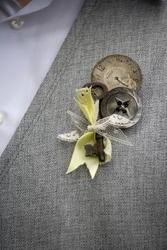 DIY boutineer. similar to this but in our colors, definitely buttons, and a sprig of lavender. maybe wrap with a ribbon in contrasting colors?