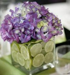 Strawberries cantalope and honeydew with flowers on top  Limes with purple flowers is wedding colors!!!
