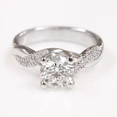This is perfect 😍 This beautiful semi-mount engagement ring showcases a half-eternity of delicate twisted strands, one of which features a total of 12 pave-set round accent diamonds leading up to your choice of center Pear Shaped Engagement Rings, Cheap Engagement Rings, Unique Diamond Engagement Rings, Engagement Ring Shapes, Wedding Accessories, Wedding Jewelry, Wedding Rings, Eternity Ring Diamond, Ring Verlobung