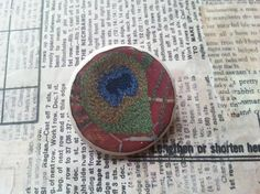 Ceramic jewellery brooch with image of my textile peacock feather designs  £9.00