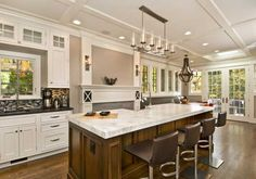 small kitchen island with cooktop and seating | Tips in choosing appropriate islands with Seating
