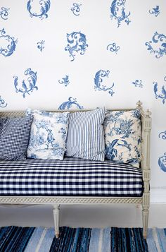 blue and white stenciling with old bench