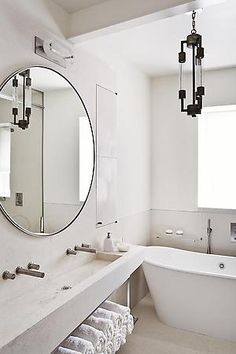 white on white bathroom, large scale mirror, wall mounted faucets, trough sink, by Julie Hillman Design
