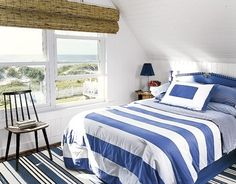The blue and white striped bedding makes this a cool and calm bedroom retreat!