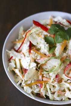 Cilantro Lime Slaw > Ingredients ½ head of green cabbage 2 carrots ½ red bell pepper ⅓ cup of mayonnaise 3 garlic gloves ¼ cup cilantro juice of 3 limes salt and pepper