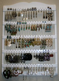 This jewelry organizer holds 90 earring pairs, 180 pairs if you use one full pair of wires in each hole and one pair in each slit, if you are not using post earrings. 7 Jewelry pegs for necklaces or, bracelets that are non-bangle. Just necklaces 7- 42 necklaces, just bracelets
