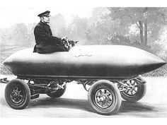 """1899. """"La Jamais Contente (English: The Never Satisfied) was the first vehicle to go over 100 kilometres per hour (62 mph). It was an electric vehicle with a light alloy torpedo shaped bodywork and with Fulmen batteries. The high position of the driver and the exposed chassis underneath spoiled much of the aerodynamics.  The light alloy, called partinium, is an alloy of aluminum, tungsten and magnesium."""""""