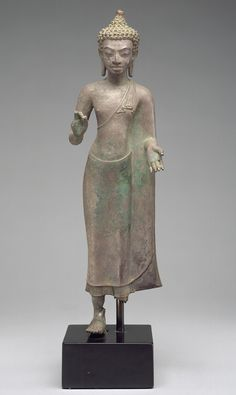 Standing Buddha, 8th–9th century; Mon style Thailand Bronze with high tin content, or silver alloy; H. 15 1/2 in. (39.4 cm) Gift of En...
