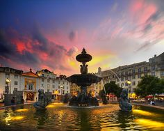 Oh Lisbon, Portugal...this is not the picture I took, because it was dumping rain while I was in this plaza! This is much prettier :)