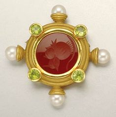 18kt gold brooch. Pearls slightly creamy , with good luster. Peridots slightly abraded, bright lime green. Carnelian intaglio is profile of a knight. Measures 1 1/2 x 1 1/2