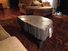 Custom gray washed Elm coffee table with metal legs.