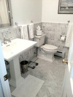 Installer: Vallefuoco ConstructionMaterial:Bianco venatino in 12x24, 3x6, and chair rail. ...