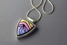 Arrow shaped pink, purple, gold, engraved dichroic art glass pendant  | GrapevineGlassArt - Jewelry on ArtFire