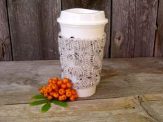 A personal favorite from my Etsy shop https://www.etsy.com/listing/96314358/coffee-cup-cozy-coffee-mug-cozy-cable