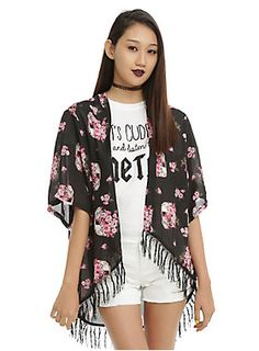 <p>Cover up with style in this black kimono with a skull and pink flowers pattern and black fringe.</p>  <ul> 	<li>100% polyester</li> 	<li>Gentle wash cold; dry low</li> 	<li>Imported</li> </ul>