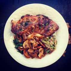 This was my dish that was posted on Gastropost Calgary: Food Photos and Food Missions for Food Lovers in Calgary :) Pork chop with bone in, mushroom and pea risotto, sauteed mushies and creamed spinach with garlic!