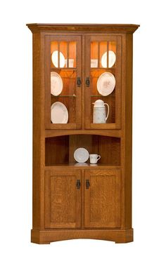 A popular space saver, the Amish Mission Corner Hutch is completely customizable. Add stunning storage to your kitchen or dining room with this beauty. The solid wood is unique and durable and will last for generations. China Cabinet Redo, Corner China Cabinets, Corner Hutch, Shelf Furniture, Amish Furniture, Mission Style Furniture, Arts And Crafts Furniture, Furniture Projects, Furniture Styles