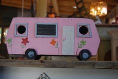 Cute pink RV birdhouse.