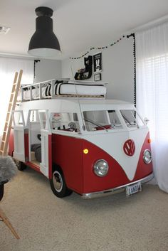 red VW van bed for two boys, one bed on the roof, the second is inside