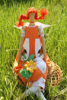 """Tilda Doll """"Garden Angel with Pumpkin"""". $30.00, via Etsy. my granddaughter would love this one...her facvorite color (of the moment) is Orange"""