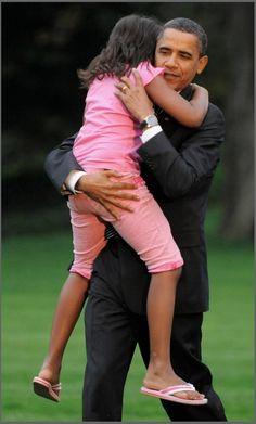 President Obama hugs his daughter Malia