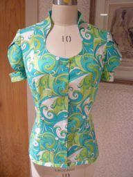 A tutorial to add a raised collar neckline to galleryany top or dress pattern.
