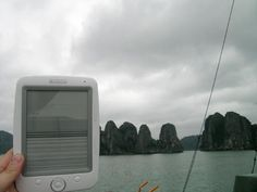 """My Opus broke (I clumsily sat on it) while on the road in beautiful Vietnam, here it is in one of the prettiest places on earth Halong Bay, don't worry it is already at the repair center in France. Before I was using it everywhere, even in the bathtub (inside a ziploc bag). I miss it.   Cheers  Lina  ps I know my photo kind of defeats the purpose of the contest, but I thought it was important to show that you can travel far with as many books as you like and that if it breaks it is…"