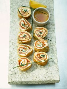 These are a kind of sushi-style take on a classic combination of smoked salmon and crème fraîche inside a pancake. You can make them up the day before, keep them in the fridge wrapped in cling film, then slice them up at the last minute. They look great if you serve them up-ended, like sushi-rolls, on a rectangular or square plate with the dip in a little bowl. You could use mustard mayo or even horseradish sauce instead of the vinaigrette dip if you like.