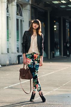 For fall, pair you floral pants with edgy leather pieces