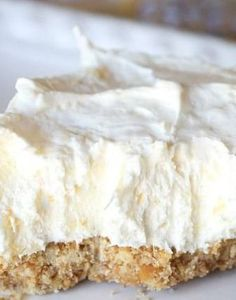 Potluck Cheesecake Dessert. A simple dessert to make for get togethers ..so easy to make and everyone will love it! Made with cream cheese, crushed pineapple, powdered sugar and cool whip